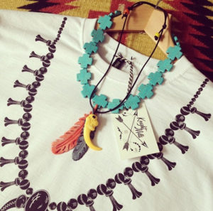 Squash blossom' tee styled with hand made necklaces.