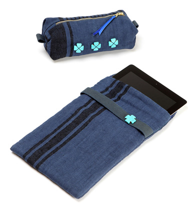 Overdyed indigo linen ipad slip case and zip pouch with buffalo stone cross detail.