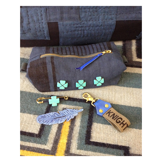 Indigo pouch, indigo dyed leather feather pin, Knight Mills military spec name tape key clip, denims Tempest wool rug and indigo boro patch duffel