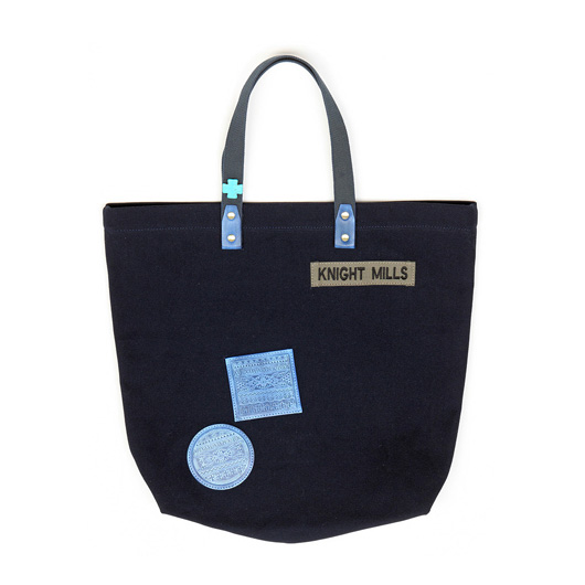 Indigo embossed leather patch detail tote, with buffalo stone cross detail and military spec Knight Mills name tape