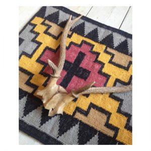 Peaks mat backed in a canvas herringbone